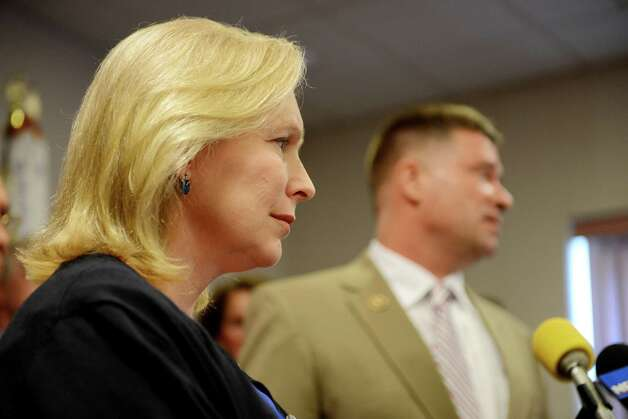 Sen. Kirsten Gillibrand, left, and Rep. Chris Gibson, right, speak during a press conference where they called for passage of legislation that would include veterans who served in the waters surrounding Vietnam among a group presumed to have been exposed to Agent Orange. They spoke on Monday, July 6, 2015, at the Joseph E. Zaloga American Legion Post 1520 in Colonie, N.Y. (Will Waldron/Times Union) Photo: WW / 00032505A
