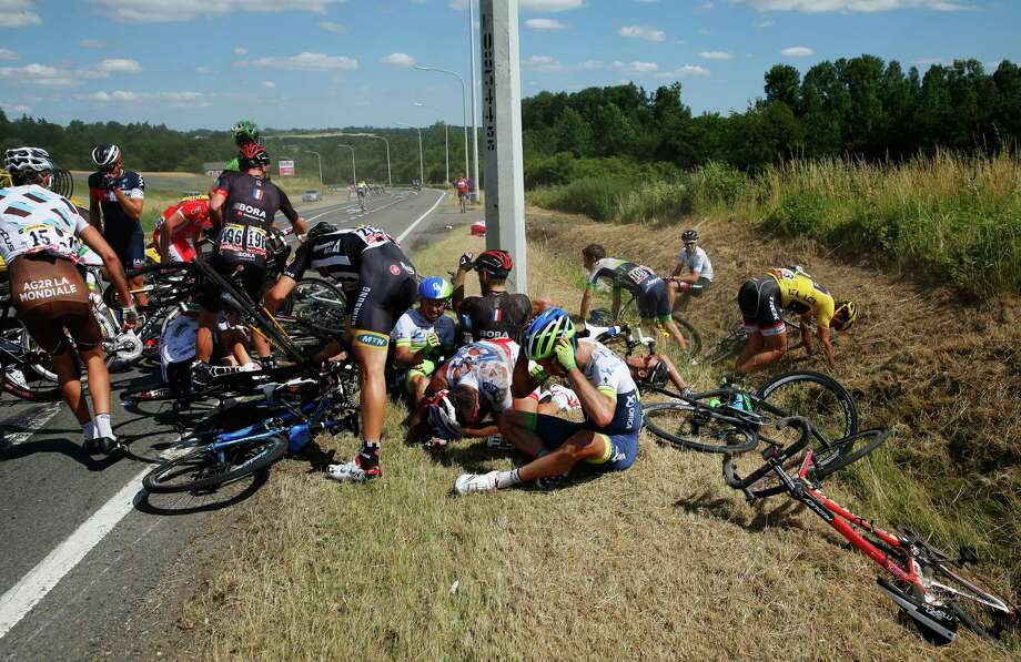 Riders get to their feet and assess damage to bikes following a crash near Brabant Wallon during stage three of the 2015 Tour de France, a 159.5 km stage between Anvers and Huy, on July 6, 2015 in Huy, Belgium. Photo: Doug Pensinger, Getty Images / 2015 Getty Images