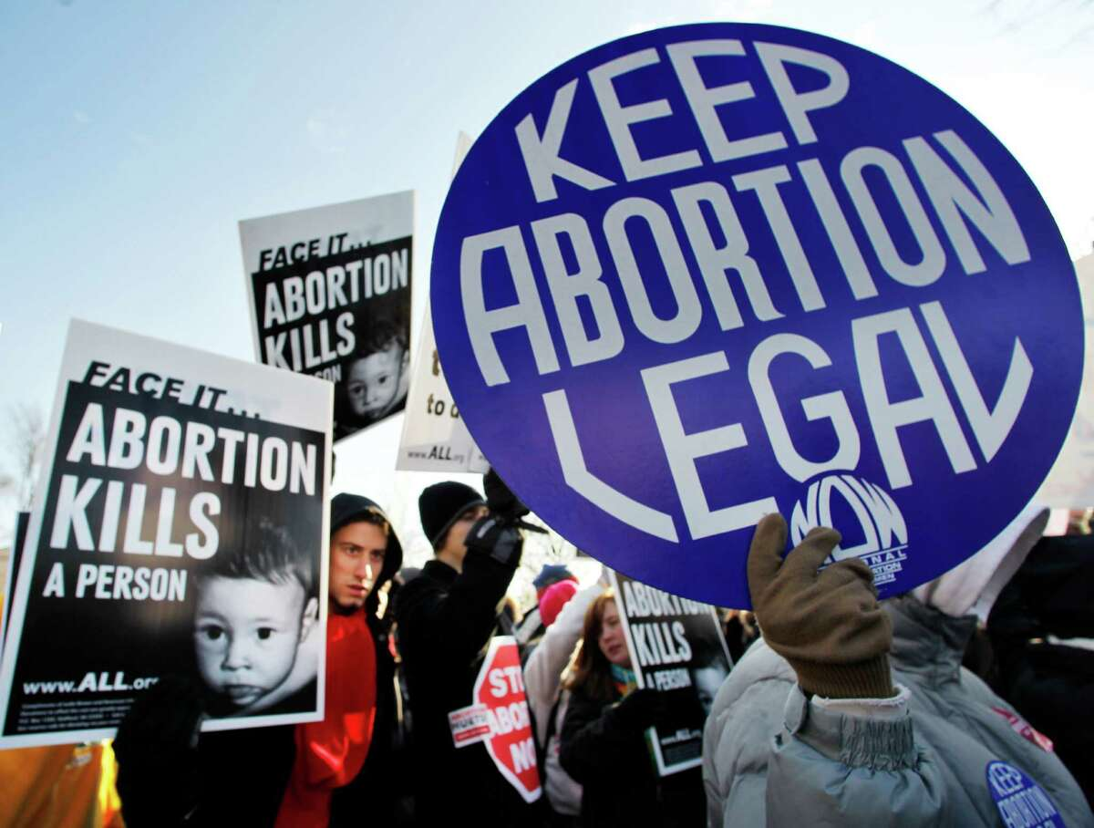 The heated debate on abortion flared anew with release of a video that shows a Planned Parenthood doctor casually discussion the sale of organs from fetuses.. In this 2011 file picture, anti-abortion and pro-choice activists stand next to each other in front of the U.S. Supreme Court in Washington during a rally on the anniversary of the Roe v. Wade decision.