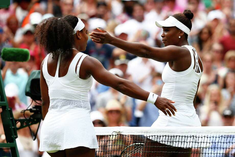 Serena Williams, left, was wondering afterward if this might be her last meeting with Venus at Wimbledon. Photo: Julian Finney, Staff / 2015 Getty Images