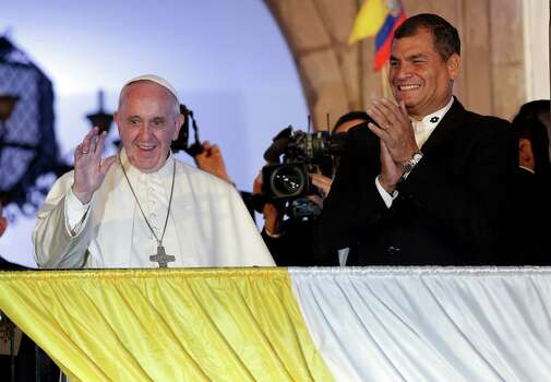 Pope Francis, left, and Ecuador's President Rafael Correa greet the crowd from government palace balcony tin Quito, Ecuador, Monday, July 6, 2015. Francis is making his first visit as pope to his Spanish-speaking neighborhood. He travels to three South American nations, Ecuador, Bolivia and Paraguay. (AP Photo/Dolores Ochoa) ORG XMIT: DOR107 Photo: Dolores Ochoa / AP