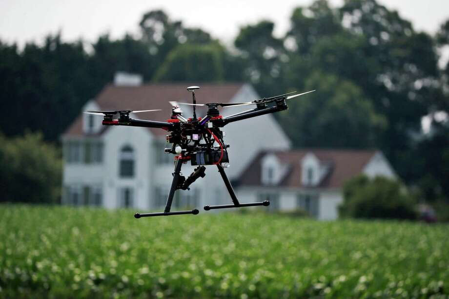 The Federal Aviation Administration has approved over 50 exemptions for farm-related operations since January. Photo: Alex Brandon, STF / AP