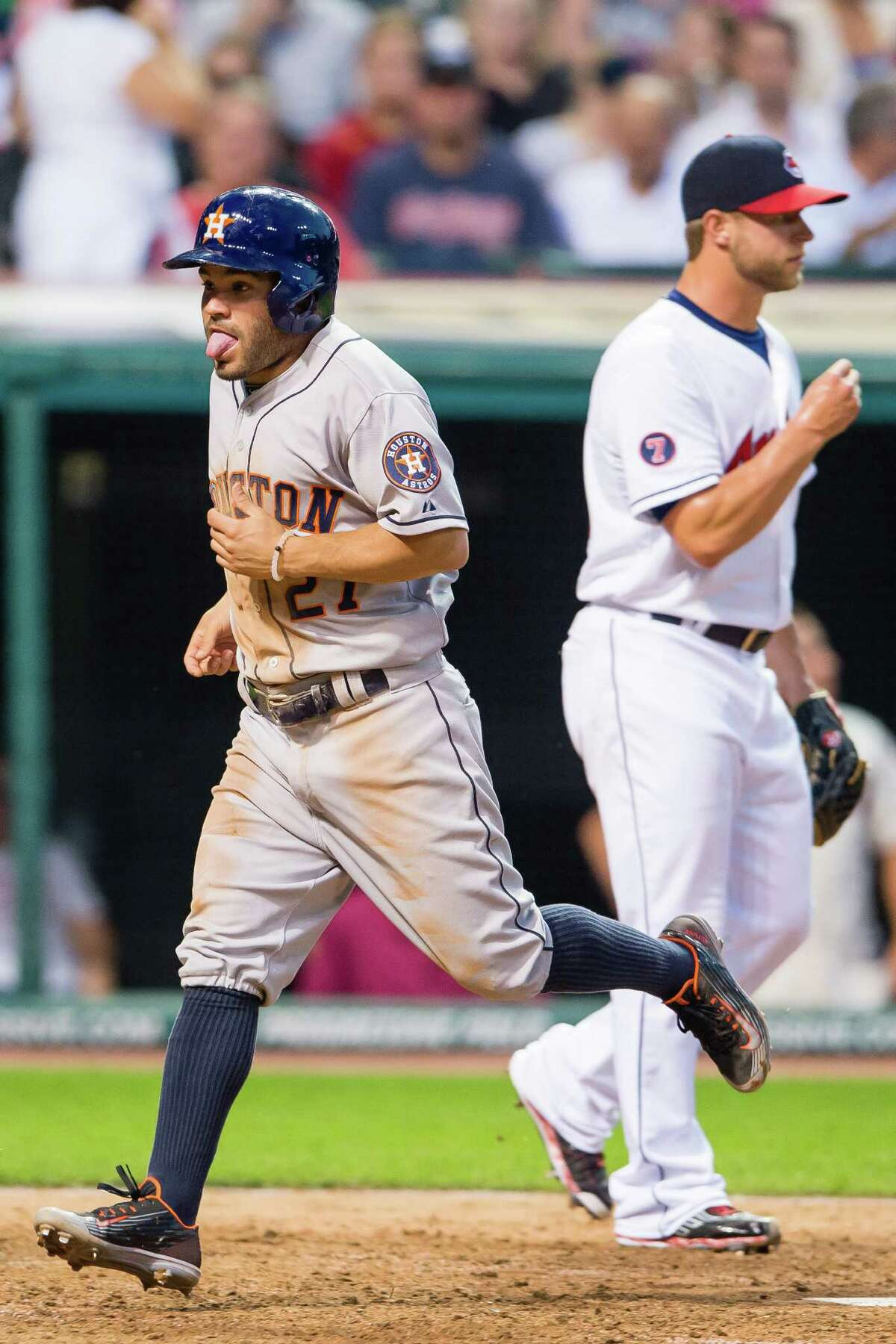 Astros second baseman Jose Altuve feels the effects of chugging around the bases to score on a single by Preston Tucker in the sixth inning.
