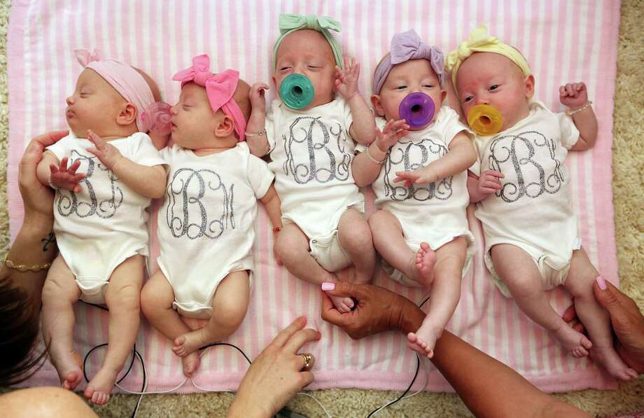 Ava Lane, Olivia Marie, Hazel Grace, Riley Paige, and Parker Kate Busby are finally together at home with parents Danielle and Adam Busby on Monday, July 6, 2015, in League City.  The last of the first all-girl quintuplets born at Woman's Hospital of Texas was released today, after a 3 month stay in the NICU. Photo: Mayra Beltran, Houston Chronicle / © 2015 Houston Chronicle
