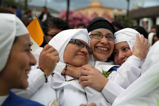 Nuns embrace at Independence square, while they wait for the Pope's arrival to the government palace in Quito, Ecuador, Monday, July 6, 2015. Pope Francis is making his first visit to his Spanish-speaking neighborhood. He travels to three South American nations, Ecuador, Bolivia and Paraguay. (AP Photo/Ana Buitron) Photo: Ana Buitron, Associated Press