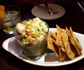 Gulf shrimp ceviche with  heirloom tomato salsa, toasted corn, avocado and house-made crackers ($16).