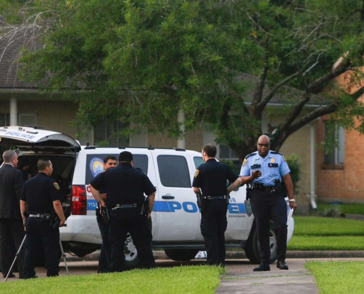 A police officer shot and killed one robbery suspect and wounded at least one other Tuesday morning after a chase in southwest Houston.
