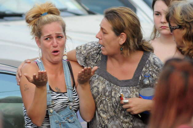 A woman who's sister was initially taken hostage, left, reacts to the standoff at a house on the corner of Grace Street and Vanderwerken Avenue on Monday, Sept. 1, 2014, Waterford, N.Y. (Cindy Schultz / Times Union archive) Photo: Cindy Schultz