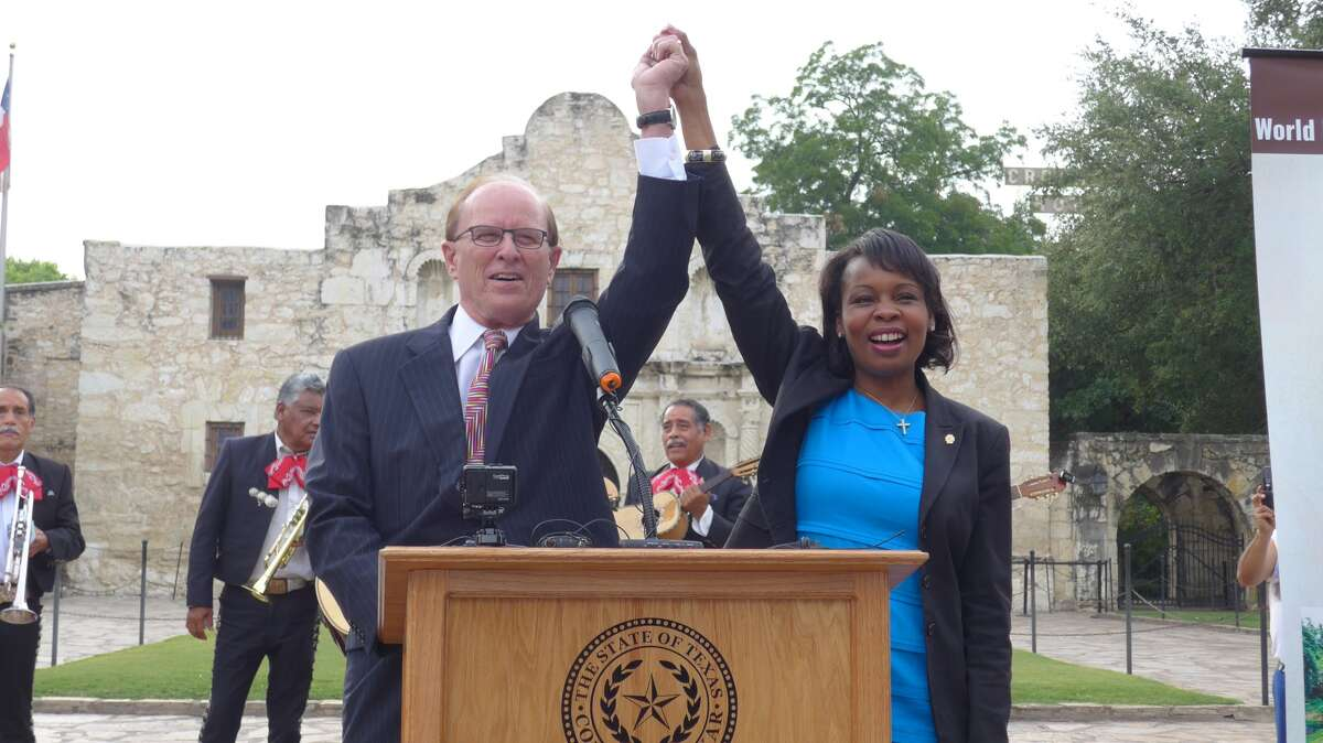 Bexar County Judge Nelson Wolff and Mayor Ivy Taylor celebrate the World Heritage designation for San Antonio's missions at the Alamo on Tuesday morning, July 7, 2015.