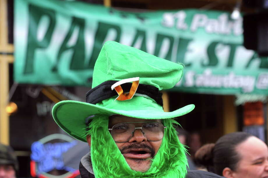 Dean Jones of Albany watches from the corner of Ouail Street and Central Avenue during the 65th Annual Albany St. Patrick's Day Parade on Saturday March 14, 2015 in Albany, N.Y.  (Michael P. Farrell/Times Union) Photo: Michael P. Farrell / 00030751A