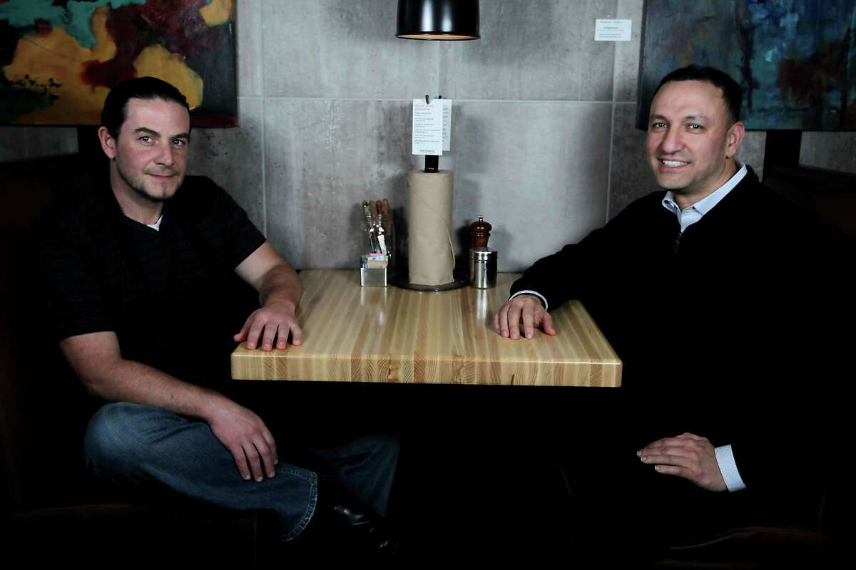 Fielding's Wood Grill culinary director and cofounder Edelberto Goncalves, left, and founder Cary Attar. Fielding's is expanding this summer, opening a second location in the new Creekside Park Village Center at the end of July.