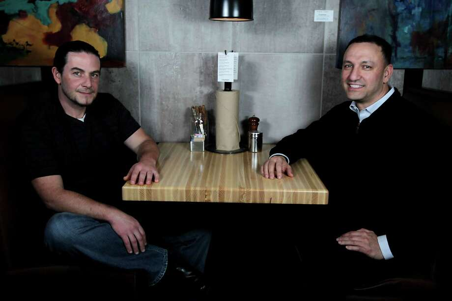 Fielding's Wood Grill culinary director and cofounder Edelberto Goncalves, left, and founder Cary Attar. Fielding's is expanding this summer, opening a second location in the new Creekside Park Village Center at the end of July. Photo: James Nielsen, Staff / © 2013  Houston Chronicle