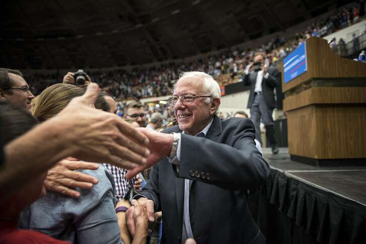 U.S. Senator Bernie Sanders, an Independent from Vermont and 2016 U.S. presidential candidate, greets supporters during a campaign rally in Madison, Wisconsin, U.S., on Wednesday, July 1, 2015. Sanders said he had attracted 200,000 donors as of mid-June and his campaign had raised $8.3 million online through June 17, according to FEC filings by ActBlue, the fundraising platform that he and some other left-leaning candidates and causes use. Photographer: Christopher Dilts/Bloomberg *** Local Caption *** Bernie Sanders