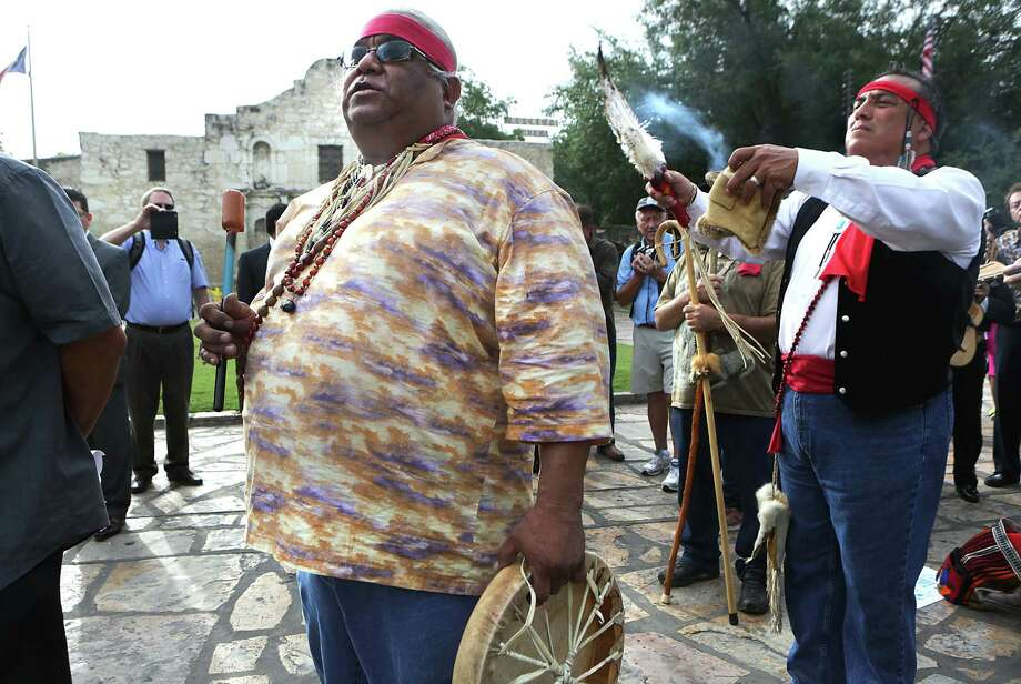 Epifanio Hernandez, left, and Adrian Ramirez, decendants of native americans, give blessing to the four corners of the earth as city leaders celebrate the announcement of the San Antonio's Spanish missions winning World Heritage Site status on Tuesday, July 7, 2015 in front of The Alamo. Photo: Bob Owen, San Antonio Express-News / San Antonio Express-News