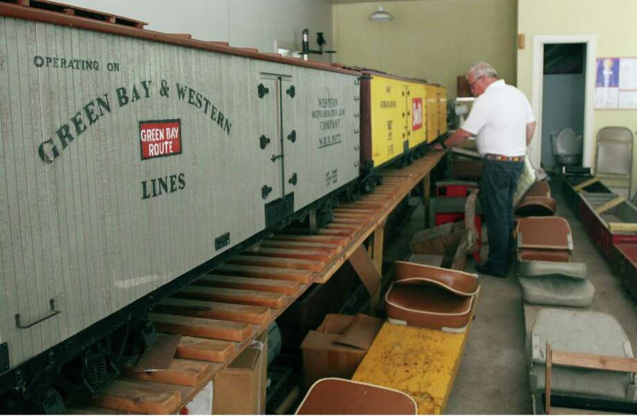 Dr. Mark Bing's collection of miniature train cars include some he built himself, others he bought from friends and several wagon cars for pulling Boy Scouts and other visitors on his private track. Photo: Jayme Fraser