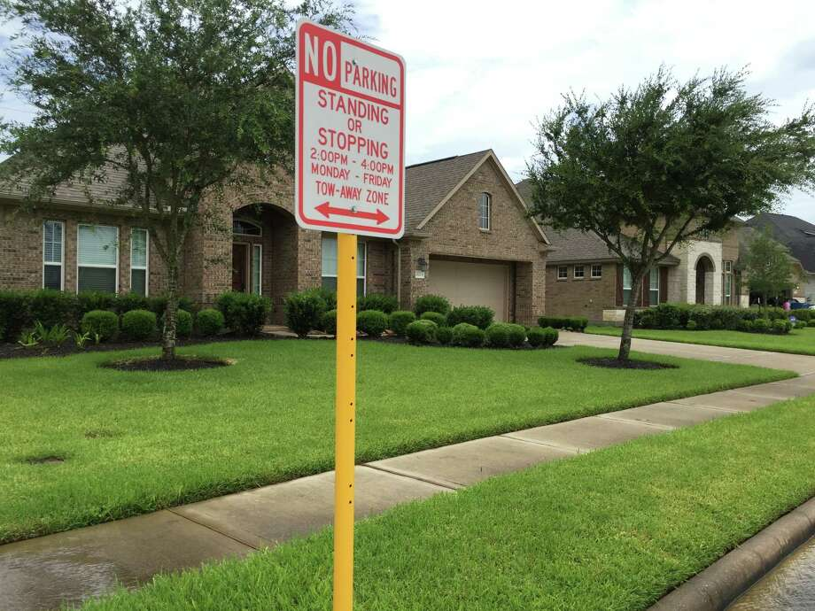 Residents of Wooded Hollow Lane want the city of Katy to change its no parking restriction on their street near WoodCreek Elementary. Photo: Sebastian Herrera / For The Chro