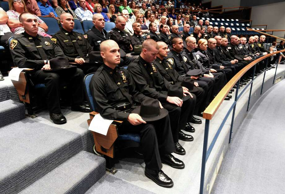 Members of the 58th session of the Zone Five Regional Law Enforcement Training Academy wait for their diplomas during graduation Tuesday morning, July 7, 2015, in Schenectady, N.Y.   (Skip Dickstein/Times Union) Photo: SKIP DICKSTEIN / 00032430A