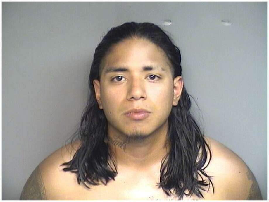 Joao Arrunategui, 24, of Port Chester was arrested Sunday for allegedly taking a picture of a woman in a bathroom stall at Cummings Beach on Sunday. Photo: Contributed / Stamford Police / Connecticut Post