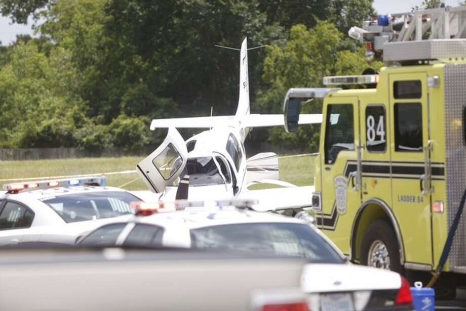 A small plane made a rough landing Tuesday in northwest Harris County at Laurel Bank Way near Laurel Arbor, according to the Department of Public Safety. Photo: Cody Duty / Houston Chronicle