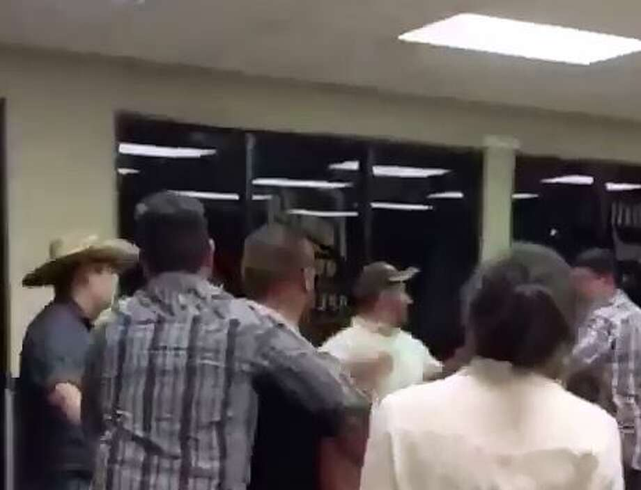 Screenshots from the video show a brawl that occurred June 26 at a Whataburger in Edinburg. Photo: White, Tyler L, Screengrab/Courtesy Photo