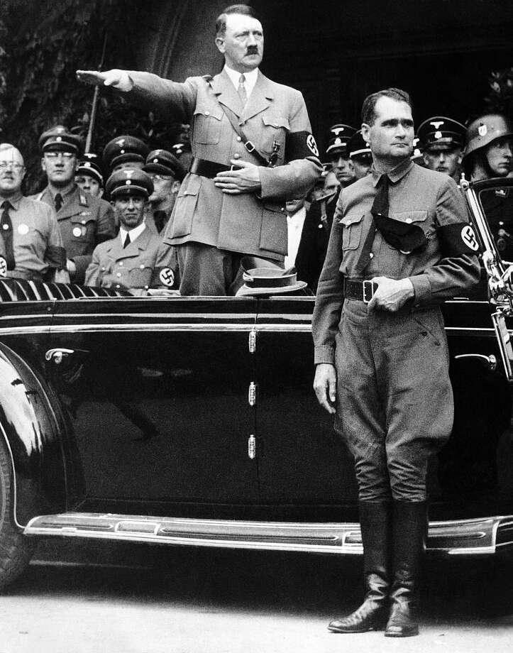 A Dec. 30 1938, file photo shows German Chancellor Adolf Hitler and his personal representative Rudolf Hess, right, during a parade in Berlin, Germany, on Dec. 30, 1938. Minister of Propaganda Dr. Joseph Goebbels can be seen on the left side next to Hitler. For more archival photos of Hitler, Nazi Germany and World War II, see the following slide show. Photo: AP
