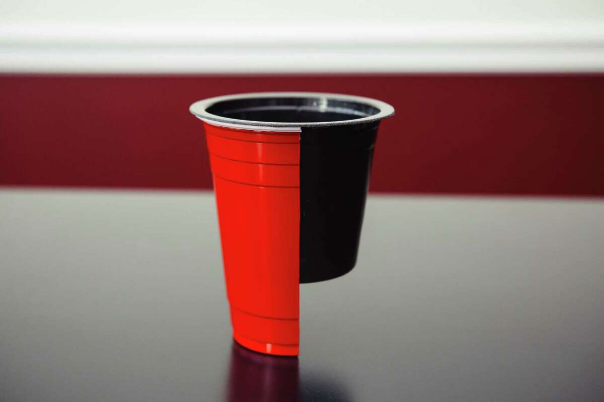 The Slip Cup sits inside of a plastic cup, which allows space underneath for the liquid to sit.