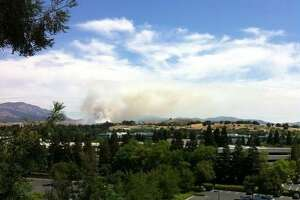 Grass fire near school burns 30 acres in Danville - Photo