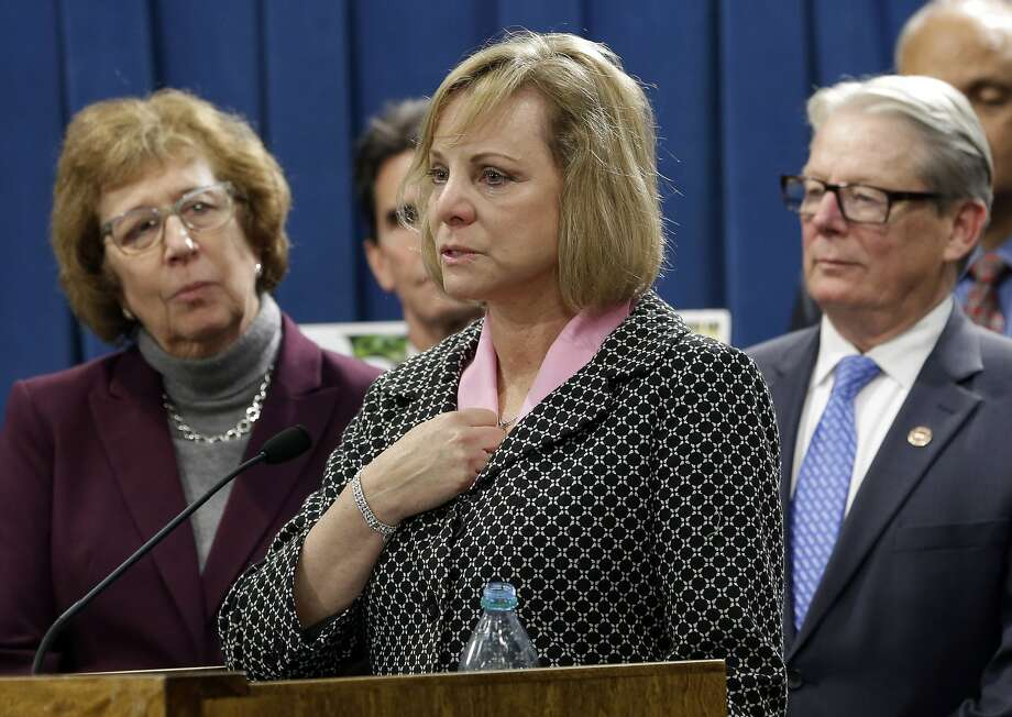 Debbie Ziegler (center), the mother of terminally ill Brittany Maynard who moved to Oregon where she could legally end her life, speaks in support of proposed legislation allowing doctors to prescribe life-ending medication to terminally ill patients during a news conference at the Capitol in Sacramento. Photo: Rich Pedroncelli, Associated Press