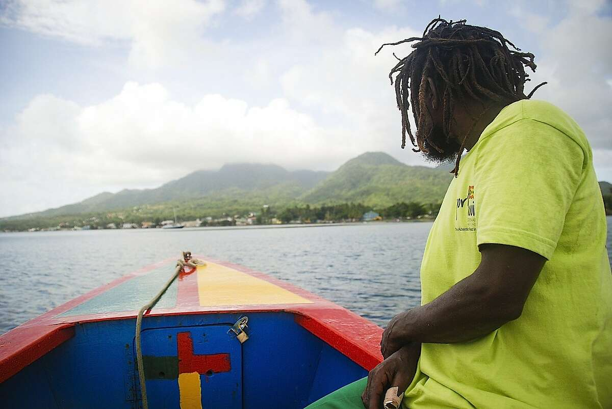 Fire is among the guides who lead rowboat tours of Dominica's Indian River.