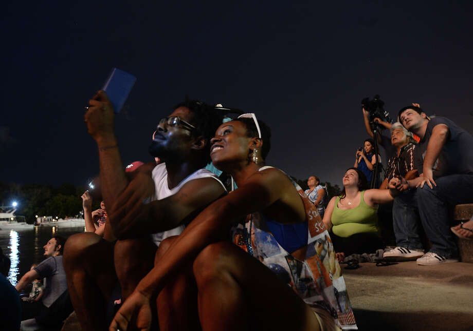 Crowds take in the fireworks over the Neches River from Riverfront Park during the City of Beaumont's annual Fourth of July celebration. Photo taken Saturday, July 04, 2015 Kim Brent/The Enterprise Photo: Kim Brent / Beaumont Enterprise