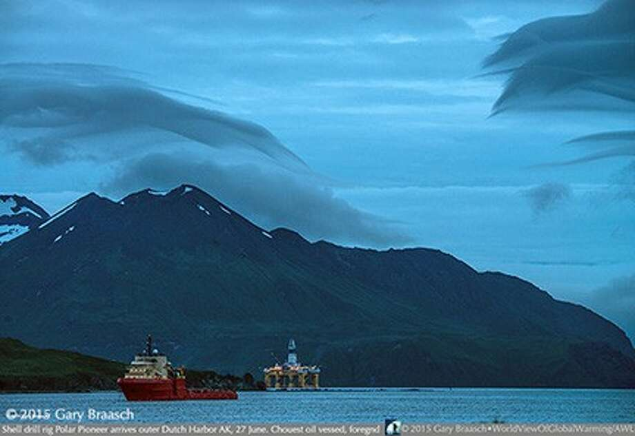 The rig appeared off Dutch Harbor in Unalaska Island in the pre-dawn hours, joining a growing flotilla of Shell's oil support vessels.  Photo by Gary Braasch. Additional images and information are available at worldviewofglobalwarming.org. Photo: Gary Braasch