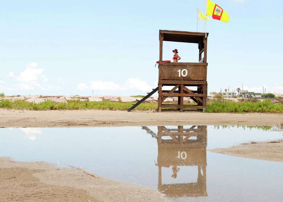 In this 2015 photo, a member of the Galveston Beach Patrol monitors swimmers from the 10th Street lifeguard tower. Photo: Alysha Beck, Freelance / Houston Chronicle