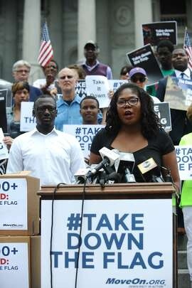 COLUMBIA, S.C. - JULY 7: ColorOfChange Media Justice Director, Brandi Collins speaks prior to delivering MoveOn petitions to take down the Confederate flag in front of the Statehouse on July 7, 2015 in Columbia, South Carolina. (Photo by Rainier Ehrhardt/Getty Images for MoveOn.org)