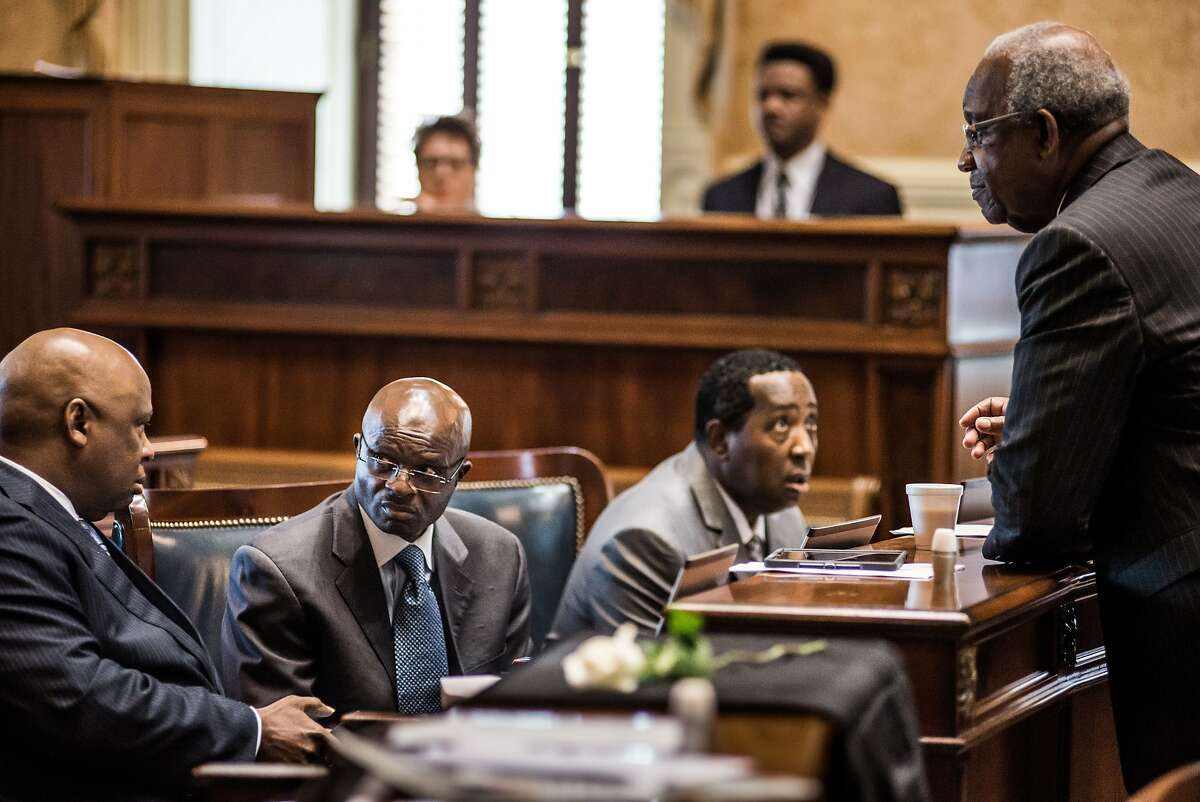 COLUMBIA, SC - JULY 7: State senators talk during the final debate in the Senate for the removal of the Confederate flag from the capitol grounds at the South Carolina Statehouse July 7, 2015 in Columbia, South Carolina. Lawmakers in the SC House of Representatives will tackle the vote next. (Photo by Sean Rayford/Getty Images)