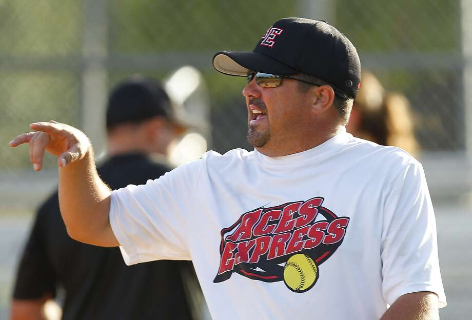 Head coach David McCorkle gives the team some instructions during the Aces Express Gold 18 and Under softball team afternoon practice in Sugar Land, TX on July 10, 2014. Photo: Diana L. Porter, Freelance / © Diana L. Porter