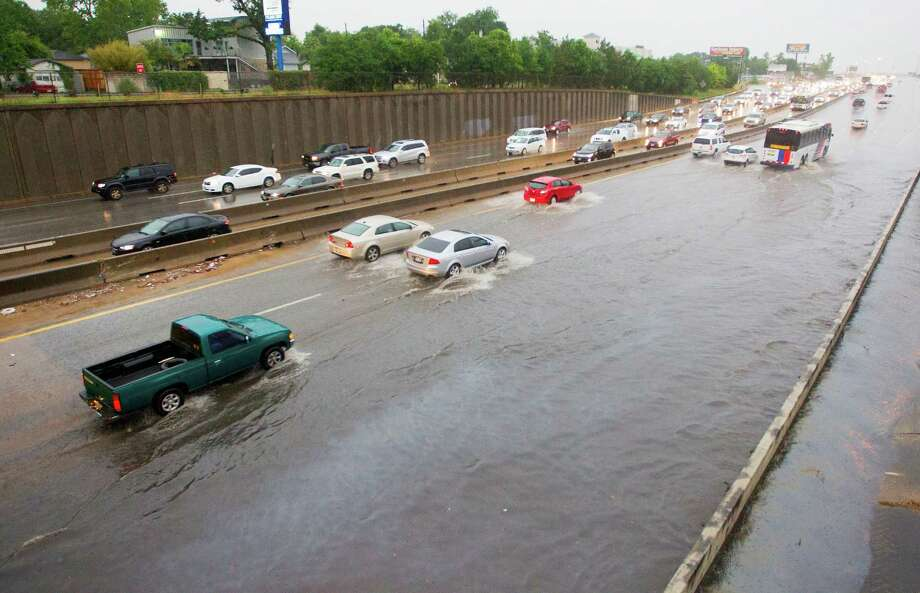 Vehicles make their way through high water along the North Freeway near N. Main, Tuesday, May 13, 2014, in Houston. (Cody Duty / Houston Chronicle) Photo: Cody Duty, Staff / © 2014 Houston Chronicle