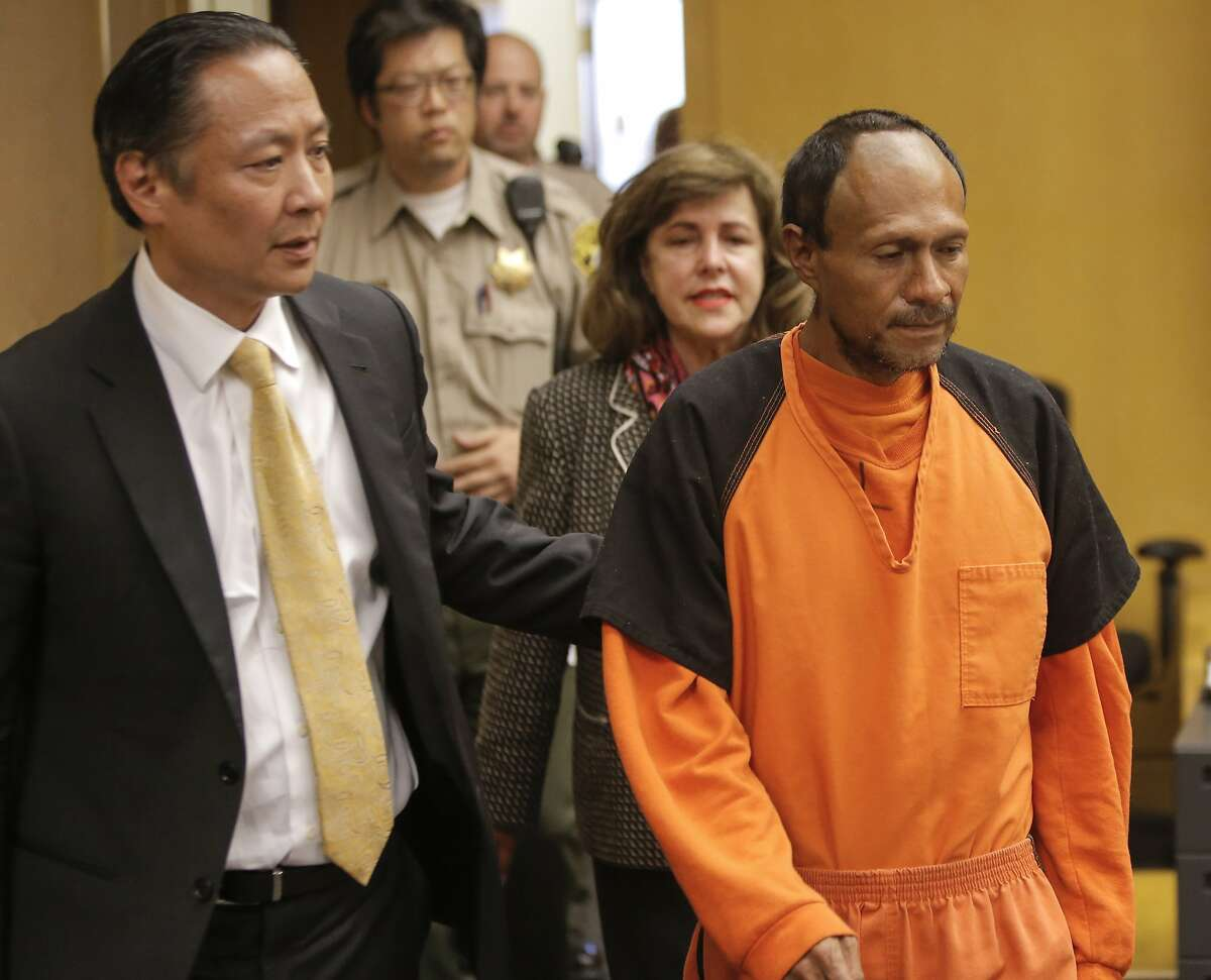 San Francisco Public Defender Jeff Adachi, (left) leads Juan Francisco Lopez-Sanchez, into the courtroom for his arraignment at the Hall of Justice in San Francisco, Calif. on Tues. July 7, 2015, on suspicion of murder in the shooting death of Kate Steinle on San Francisco's Pier 14 last Wednesday.San Francisco assistant district attorney Diana Garcia follows behind.