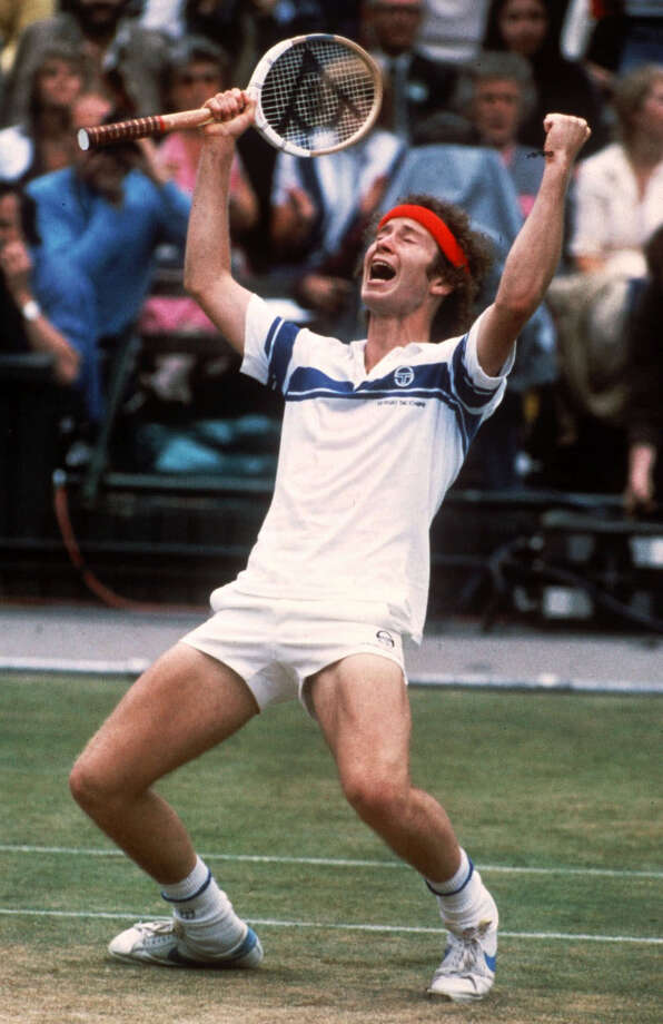 In this July 4, 1981 file photo, John McEnroe celebrates his victory after defeating Bjorn Borg to take the Wimbledon men's singles title at the All-England Lawn Tennis Championships in Wimbledon, London. A year after losing to Borg, in one of the greatest matches ever played, McEnroe got his revenge ending Borg's 5 year domination of Wimbledon. The serve-and-volley tactics of McEnroe, who had caused some controversy earlier in the tournament with a couple of foul-mouthed tirades, proved too much for Borg, who lost in four sets. McEnroe would win another two Wimbledons. Borg never graced the tournament again. (AP Photo/Adam Stoltman, File) Photo: Adam Stoltman /Associated Press / AP