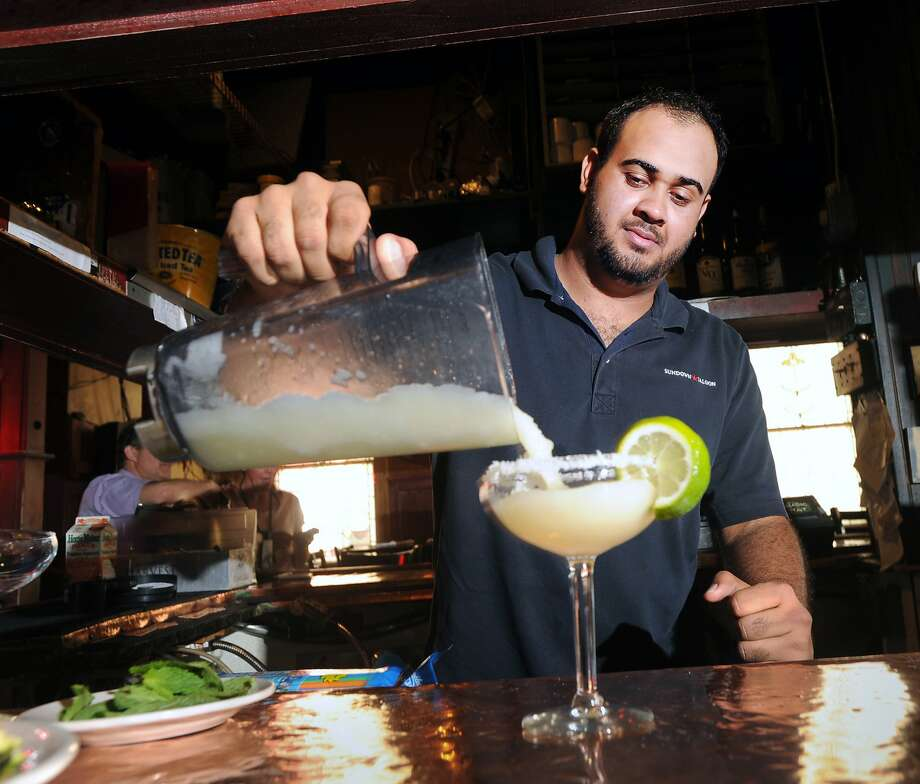 "Bartender Wellington Goncalves makes a frozen ""Sheriff"" Margarita made with Jose Cuervo 1800 and fresh squeezed lime Margarita mix at the Sundown Saloon in Greenwich, Conn., Wednesday, July 1, 2015.