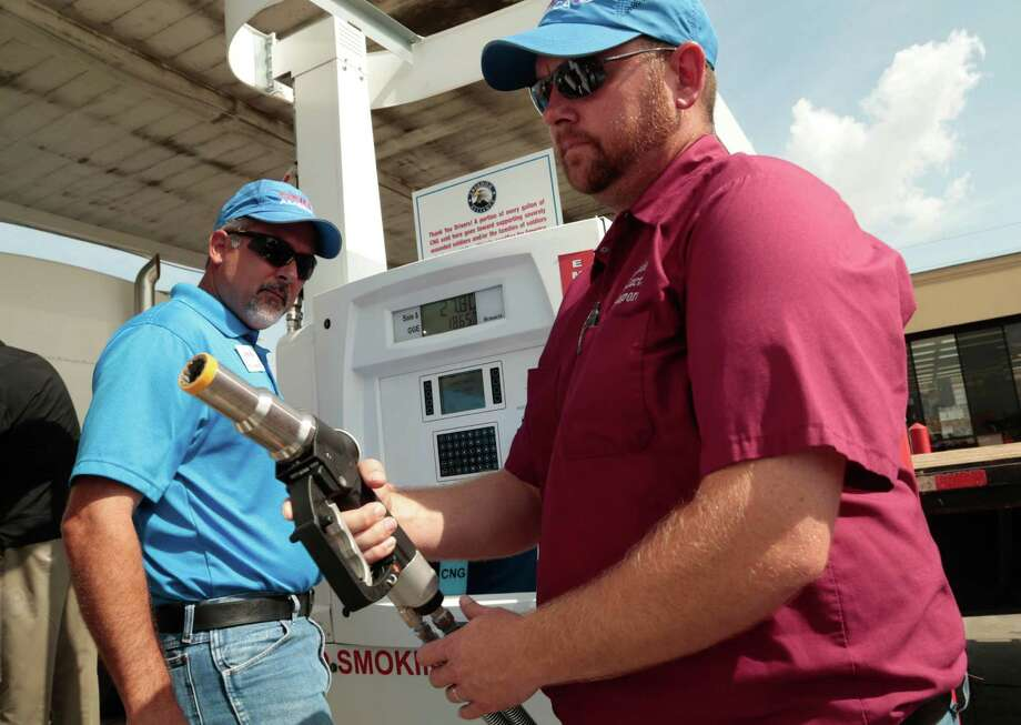 (right) Jay Smith of Building Products Transport fills his big rig up at a Natural Gas filling station at a Texaco in Katy, Texas Tuesday July 7, 2015. CNG 4 America opened a new Natural Gas fueling facility at the Texaco Station at 24985 Katy Freeway. (Billy Smith II / Houston Chronicle) Photo: Billy Smith II, Staff / © 2015 Houston Chronicle