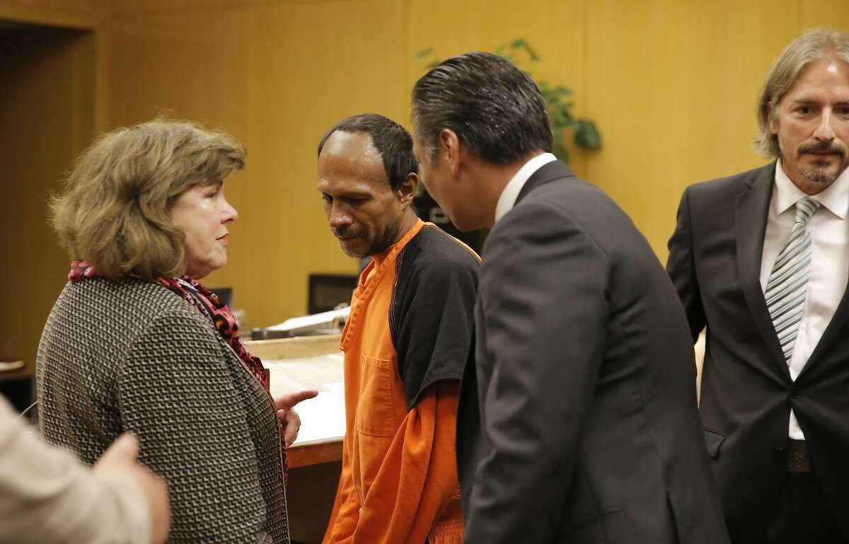A Spanish language interpreter, (left) is nearby as Juan Francisco Lopez-Sanchez, is led away by Public Defender Jeff Adachi, (middle right) and Sanchez's co- attorney Matt Gonzalez, (right) after his arraignment at the Hall of Justice in San Francisco, Calif. on Tues. July 7, 2015, on suspicion of murder in the shooting death of Kate Steinle on San Francisco's Pier 14 last Wednesday.