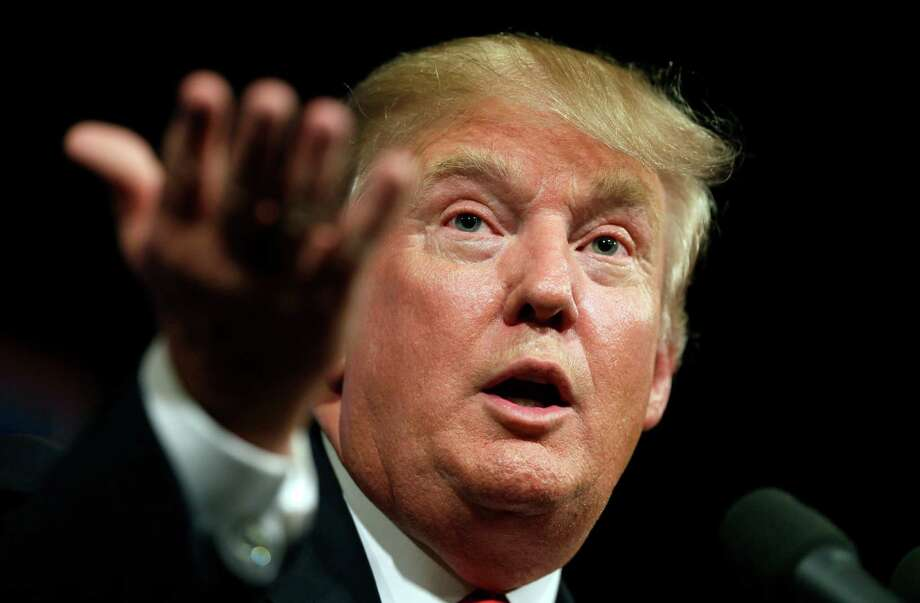 FILE- In this June 16, 2015 file photo, Republican presidential candidate Donald Trump speaks to supporters during a rally in Des Moines, Iowa. Donald Trump's lawyers said Trump and the Miss Universe pageant have sued Univision for $500 million on Tuesday, June 30, 2015, claiming Trump's First Amendment rights were violated when the company backed out of its contract to air the Miss USA contest. (AP Photo/Charlie Neibergall, File) Photo: Charlie Neibergall, STF / AP
