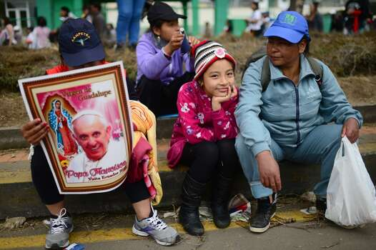 Faithful await for the passage of Pope Francis in Quito, on July 7, 2015. Pope Francis celebrated his second open air mass in as many days in Ecuador on Tuesday, this time in Quito, the capital city roiled for the past month by anti-government protests. Photo: MARTIN BERNETTI, AFP/Getty Images