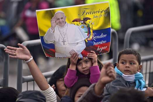 Faithful participate in an open-air mass celebrated by Pope Francis at Bicentennial Park in Quito, on July 7, 2015. Photo: RODRIGO BUENDIA, AFP/Getty Images