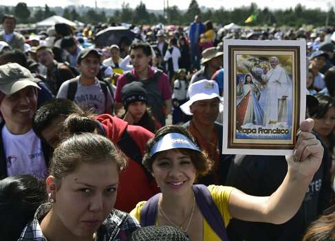 Hundreds of faithful gather before the start of an open-air mass by Pope Francis at the Bicentennial Park in Quito, Ecuador, on July 7, 2015. A huge throng of worshippers is expected for Pope Francis second open air mass. The visit of the Argentine-born pontiff comes amid widespread unrest over the socialist policies of President Rafael Correa --who is expected to attend the mass. Photo: RODRIGO BUENDIA, AFP/Getty Images