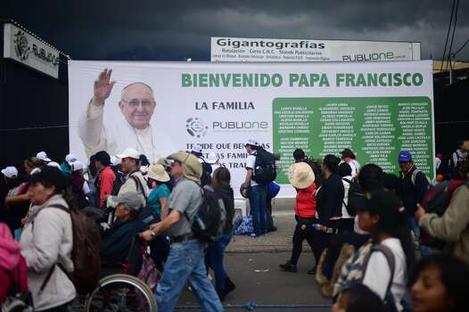 Faithful returning from the open-air mass officiated by Pope Francis walk along the streets of Quito, on July 7, 2015. Pope Francis celebrates his second open air mass in as many days in Ecuador on Tuesday, this time in Quito, the capital city roiled for the past month by anti-government protests. Photo: MARTIN BERNETTI, AFP/Getty Images