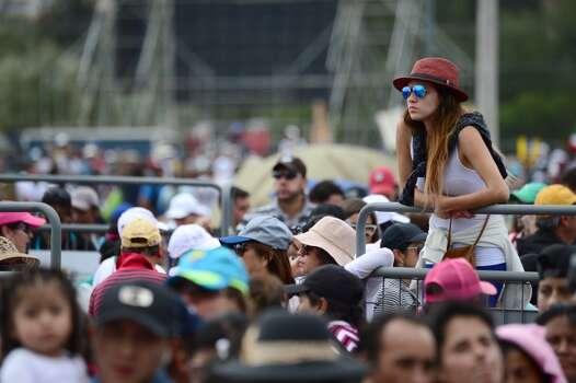 Faithful participate in an open-air mass officiated by Pope Francis at Bicentennial Park in Quito, on July 7, 2015. Pope Francis celebrates his second open air mass in as many days in Ecuador on Tuesday, this time in Quito, the capital city roiled for the past month by anti-government protests. Photo: MARTIN BERNETTI, AFP/Getty Images
