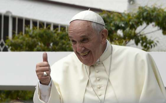 """Pope Francis gives his thumb up from the popemobile in Quito, on July 7, 2015. Pope Francis celebrated his second open air mass in Ecuador and has called for greater """"dialogue"""" and """"participation without exclusion"""". Photo: JUAN CEVALLOS, AFP/Getty Images"""