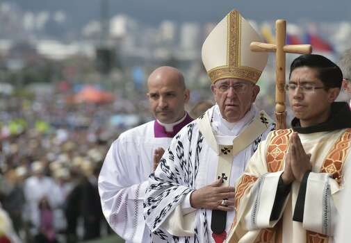 Pope Francis heads for an open-air mass at the Bicentennial Park in Quito, Ecuador, on July 7, 2015. The visit of the Argentine-born pontiff comes amid widespread unrest over the socialist policies of President Rafael Correa --who is expected to attend the mass. Photo: VINCENZO PINTO, AFP/Getty Images
