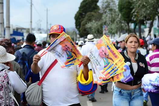 A peddler sells memorailia  of Pope Francis in Quito, on July 7, 2015. Pope Francis celebrates his second open air mass in as many days in Ecuador on Tuesday, this time in Quito, the capital city roiled for the past month by anti-government protests. Photo: MARTIN BERNETTI, AFP/Getty Images